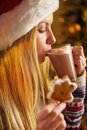 Profile teenager girl drinking hot chocolate portrait of cup of with marshmallow and christmas cookie Stock Photography