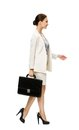 Profile of walking businesswoman with suitcase case isolated on white concept leadership and success Royalty Free Stock Photography