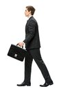Profile of walking with suitcase business man full length case isolated on white concept leadership and success Stock Photo