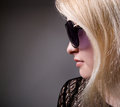 Profile of a woman in fashion sunglasses on gray background Royalty Free Stock Photos