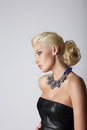 Profile of young contemplating blonde with necklace cute Stock Images