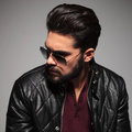 Profile of a young man in sunglasses and leather jacket Royalty Free Stock Photo