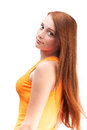 Profile of a young red haired girl in a bright shirt isolated o Royalty Free Stock Photography