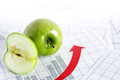 Profit concept closeup of half and whole apple on paper background with chart Stock Photo