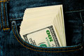 Profit pack of dollars in a jeans pocket Stock Photography