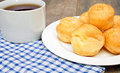 Profiteroles and a cup of tea Royalty Free Stock Image