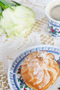 Profiteroles, rose and coffee Royalty Free Stock Photo
