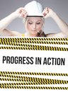 Progress in action sign on information poster worker woman and Royalty Free Stock Photo