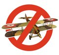 Prohibition of biplane with military camouflage. Strict ban on construction of aircraft with two wings. Stop World War. Royalty Free Stock Photo