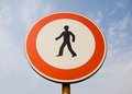 Prohibition of pedestrians sign against sky from below Royalty Free Stock Photography