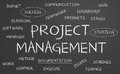 Project management word cloud written on a chalkboard Royalty Free Stock Photos