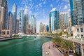Promenade and canal in Dubai Marina with luxury skyscrapers around,United Arab Emirates Royalty Free Stock Photo