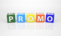 Promo out of multicolored letter dices the word Royalty Free Stock Photos