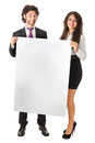 Promoting together an elegant business couple holding a blank whiteboard and something Royalty Free Stock Images
