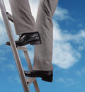 Promotion concept businessman climbing the ladder of success Stock Images