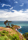 Promthep cape phuket viewpoint in thailand andaman sea and white clouds on blue sky laem phromthep Stock Photography