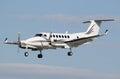 Prop plane landing a small white Royalty Free Stock Image
