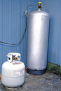 Propane tanks two small for grille large for kitchen stove Stock Image