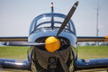 Propeller aircraft front view of with yellow nose Royalty Free Stock Photos