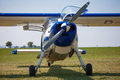 Propeller aircraft sportive parking in blue and white Royalty Free Stock Image