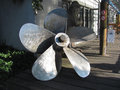 Propeller antique that is on the street Stock Photos