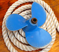 Propeller blue for boat at pile of rope Stock Image