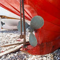 Propeller a on a red hulled boat Royalty Free Stock Images