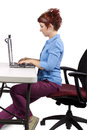 Proper posture young woman demonstrating office desk Stock Photos