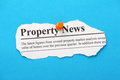 Property news newspaper clipping for pinned to a blue paper background Royalty Free Stock Photos