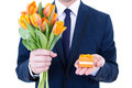Proposal man holding gift box and flowers with wedding ring isolated on white background Royalty Free Stock Photos