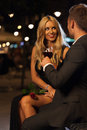 Proposal toast in the city a beautiful women and elegant men celebrating his Royalty Free Stock Images