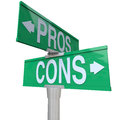 Pros and cons two way street signs comparing options a green sign pointing to your so you can decide the best choice for you make Royalty Free Stock Photo