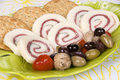 Prosciutto cheese plate and olives Royalty Free Stock Photo