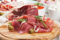 Prosciutto di parma italian cured pork meat on cutting board Royalty Free Stock Images