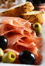 Prosciutto di Parma with olives Royalty Free Stock Photography