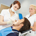 Prospective dentist taking test with patient female dental Stock Image