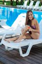 Prosperous businesswoman relaxing near pool outside the city Royalty Free Stock Photo