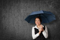 Protect against something friendly businesswoman hide and herself under umbrella Stock Image