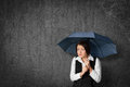 Protect against something worried businesswoman hide and herself under umbrella Stock Photo