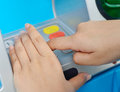Protect of ATM pin by hands Royalty Free Stock Image