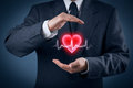 Protect health healthcare and heart problems prevention cardiology concept cardiologist with protective gesture and symbol of Royalty Free Stock Photo
