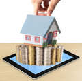 Protect your house in hand businessmen and shows tablet Stock Image