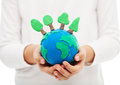 Protecting the forests and ecology concept child hand holding earth globe with trees Stock Photography