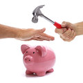Protecting your assets hand with hammer about to smash piggy bank to get at savings being protected by another hand concept for Stock Photos