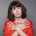 Protection concept for displeased beautiful mature woman Royalty Free Stock Photo