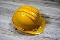 Protection helmet a yellow plastic used on construction sites for head Stock Image