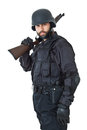 Protection is my business a swat agent wearing a bulletproof vest and aiming with a gun Royalty Free Stock Images
