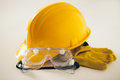 Protective construction worker workwear yellow hardhat glasses and gloves for construciton workers Stock Photography