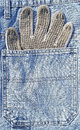 Protective glove jeans pocket Royalty Free Stock Photo