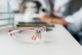 Protective goggles on table in chemical laboratory Royalty Free Stock Photo